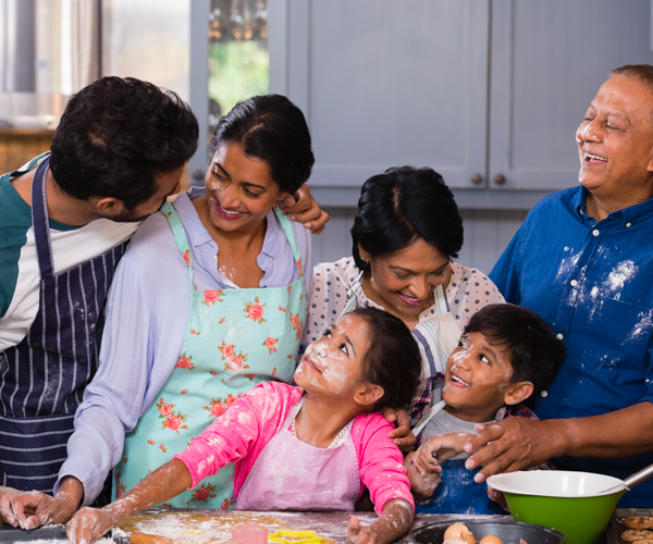 Multi-generational family cooking together